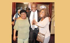 Opposition Leader Lennox Linton, poses with members of the Dominica Diaspora