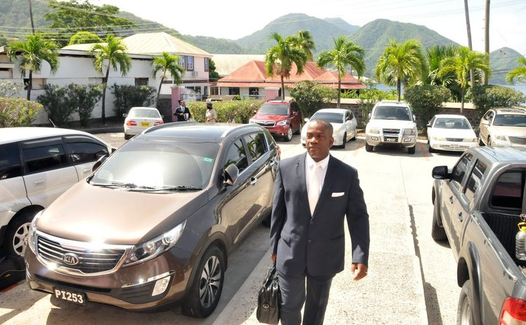 Opposition leader Lennox Linton goes to parliament on Budget Day 2015