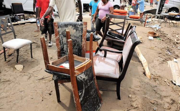 Looted furniture on street outside Courts