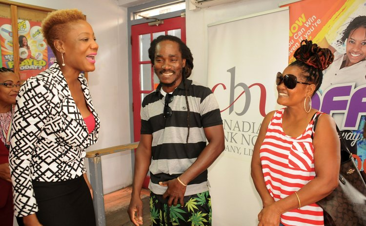 Lottery Super Six winner, Laville (centre) shares the joy of winning at the DNL office