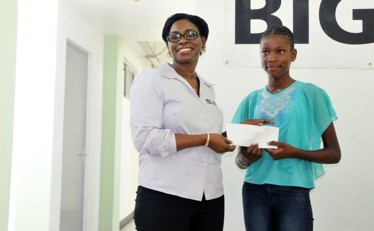 Mrs Doctrove presents scholarship award to Jarnila Phillip