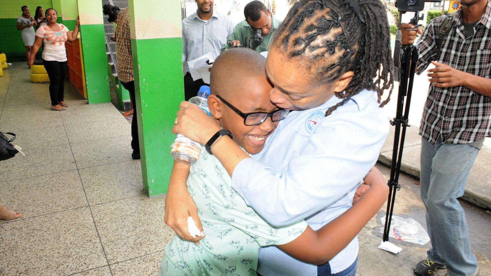 Bertilia McKenzie hugs her son