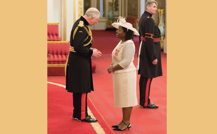 Olive (Collaire) Strachan recently received an MBE award from Prince Charles at Buckingham Palace