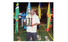 Coach Mickey Joseph with Dominica's 3rd place trophy, Windward Islands Basketball Championships, Grenada, 2010