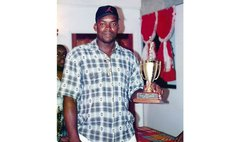 Milton Paul (Deceased) with one of Knicks' team trophies; died in 2014