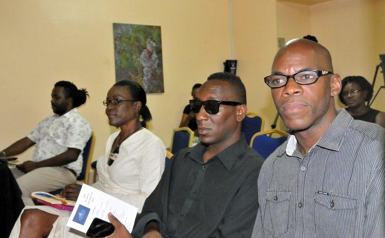 Dominica's representative (right) at the Mr Caribbean pageant