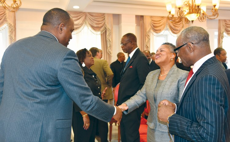 Hon. Dame Janice M. Pereira DBE, Chief Justice of the OECS Supreme Court greets PM Skerrit at an official function at the State House
