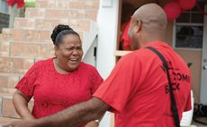 Octavia Alfred, left, greets a supporter