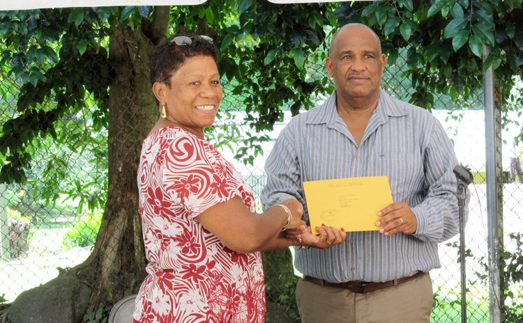Abraham receives gift from Mrs Savarin, wife of the President of Dominica