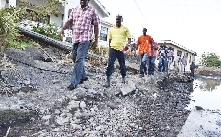 PM Skerrit, front and Hector John, second in row, visit Coulibistrie after the storm