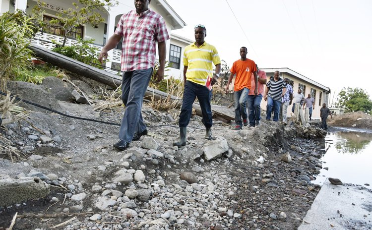 Touring the Colibistrie disaster area after Erika, John , 2nd, PM Skerrit, first in row, and others