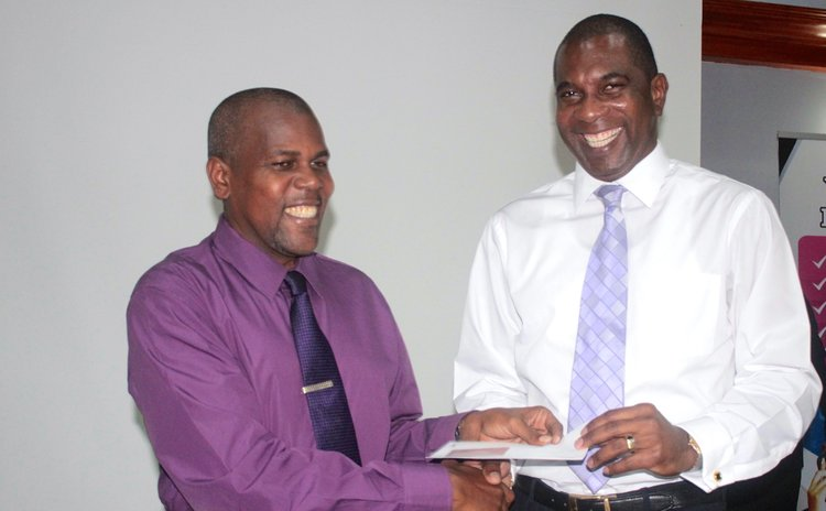 NCCU manager Aylmer Irish receives gift from LIME CEO Baptiste
