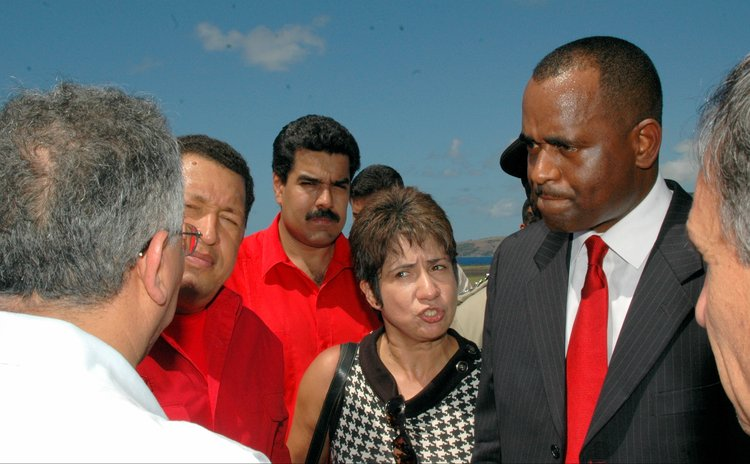 FILE PHOTO: Late Venezuelan President Chavez on first visit to Dominica; current President Maduro in the background
