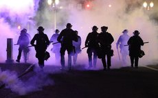 Police use tear gas to control demonstrators in George Floyd  death protest
