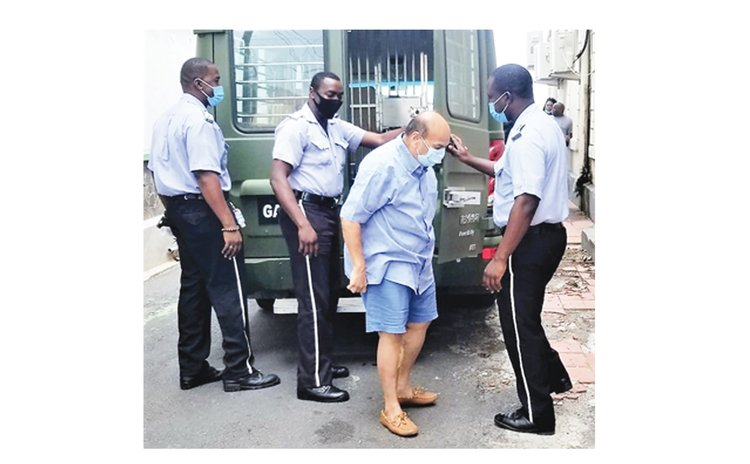 On his way to court to answer charges of illegal entry into Dominica