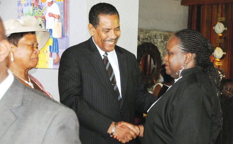 President Savarin greets Judge Stevenson at the inauguration reception of the President