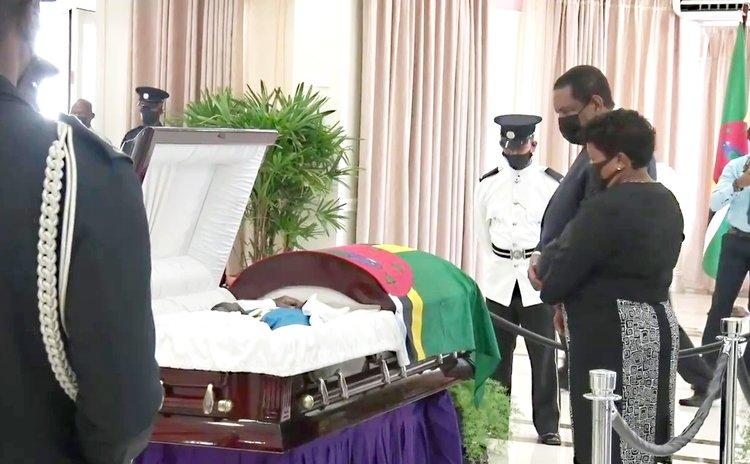 At the viewing of the body of Patrick John, President Charles Savarin and Mrs. Savarin