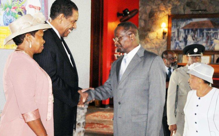 Former President Dr. Liverpool greets new President Charles Savarin and Mrs. Savarin