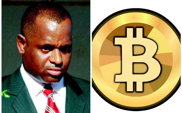 Prime Minister Roosevelt Skerrit and bitcoin sign