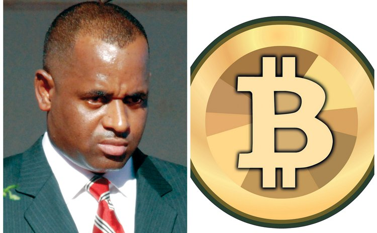 Prime Minister Skerrit and BitCoin logo