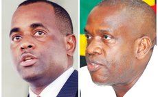 Left to right: Prime Minister Roosevelt Skerrit and UWP political leader Lennox Linton