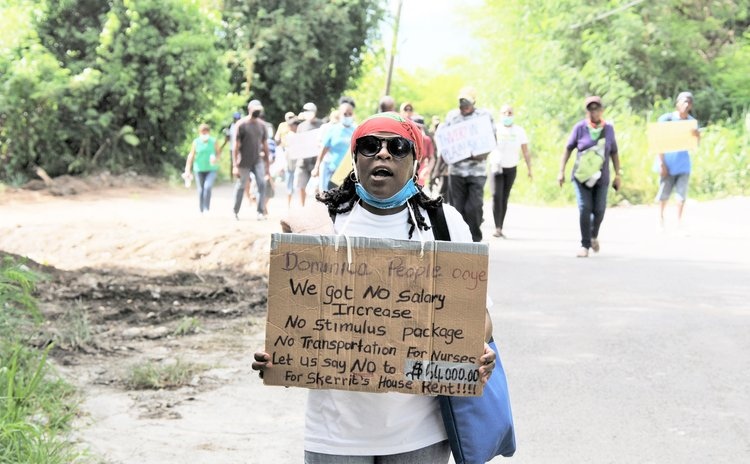 Protester on walk to Skerrit residence at Morne Daniel