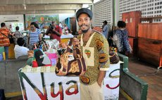 A proud Dominican displays his creations at an Expo