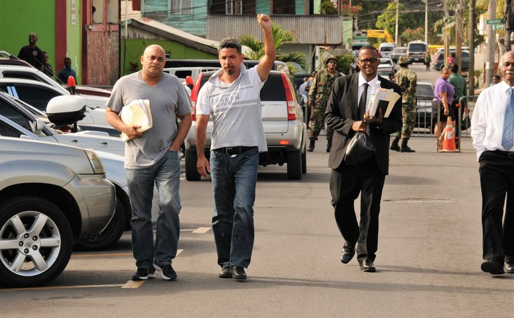 Sanford (second from left) and his lawyers leave police headquarters after the arrest