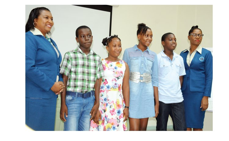 Scholarship Recpients and officials of DOMLEC pose at the ceremony