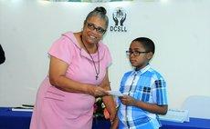 Sev Sage McKenzie receives scholarship award from DCSLL president Josephine Dublin