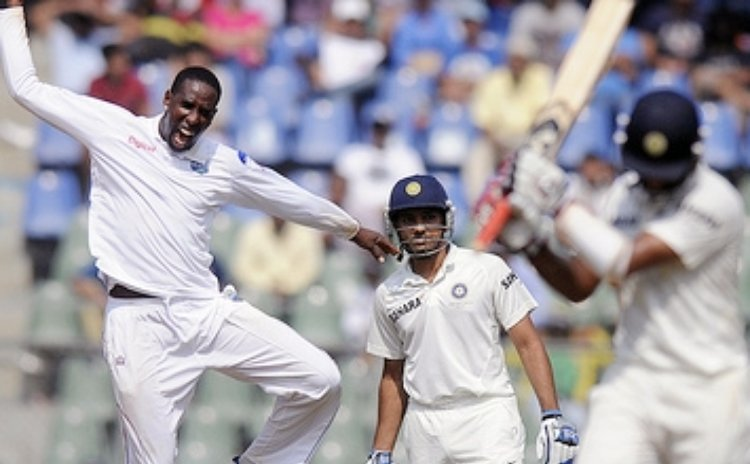 Shane Shillingford celebrates taking another Indian wicket
