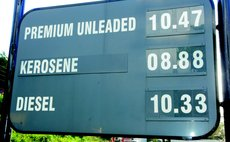 sign showing latest prices at the NP station in Canefield