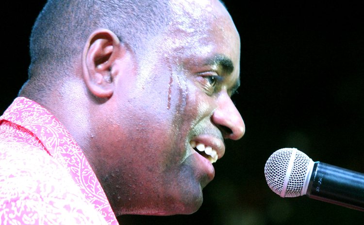 Roosevelt Skerrit speaks at a rally in Salybia
