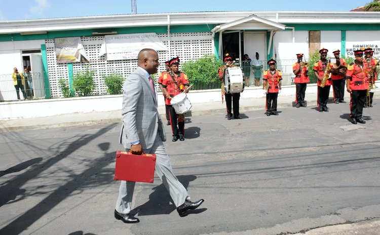 Prime Minister Skerrit, with Government Band in the background, goes to parliament to deliver the 2018/ 2019 national budget
