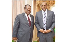 Former CCJ president Sir Denis Byron and Prime Minister Skerrit in 2015