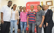 Students and their parents pose with Bank Staff