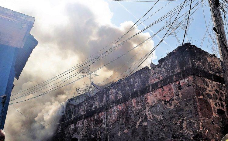Old Prison on John's Avenue, Roseau, burns