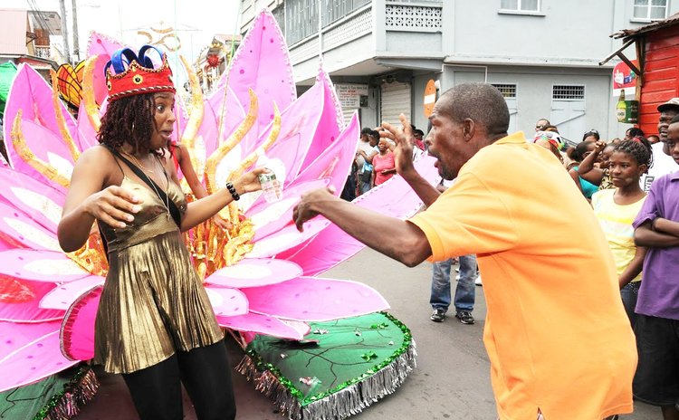 Sour-Sour and Tasha P make faces at each other in the carnival band on Kennedy Avenue, Roseau, in 2011
