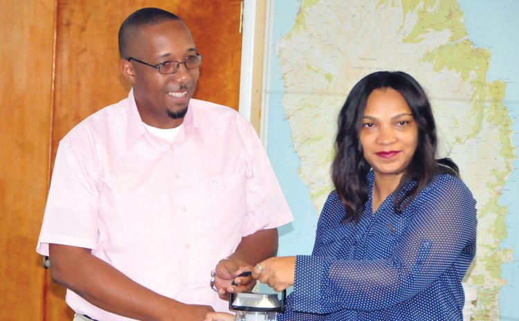 Steve Joseph of Local Government , left , and Gelina Fontaine of Child Fund shake hands at the function