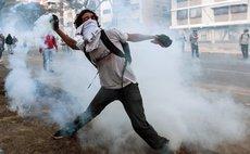 CARACAS, Feb. 20, 2014 (Xinhua) -- A student participates in a protest in Altamira, in the municipality of Chacao, Caracas, Venezuela, on Feb. 19, 2014. (Xinhua/Boris Vergara
