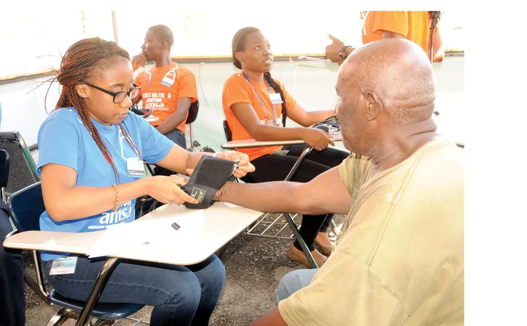 Taking Blood Pressure at an All Saints University Clinic