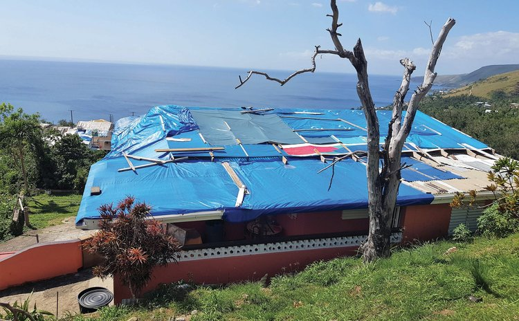 House at upper Canefield damaged by Hurricane Maria