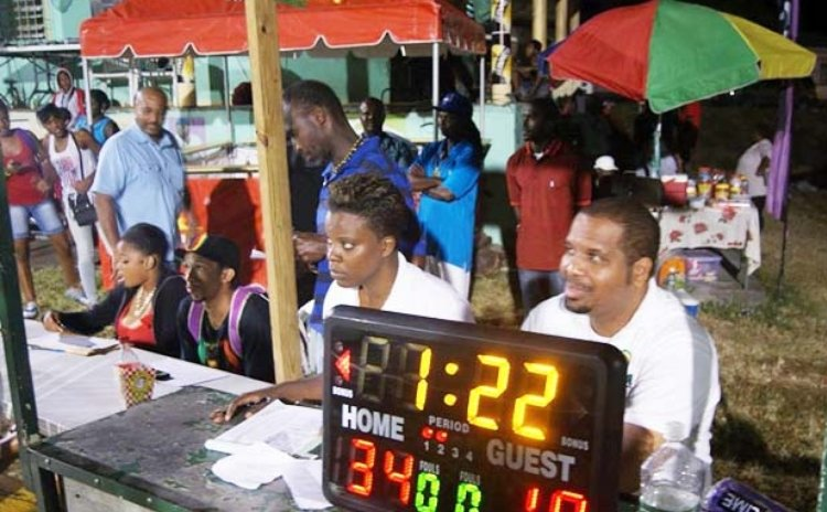 Table Officials with mini electronic scoreboard at national league game, Lindo Park, 2014.  Photo courtesy DABA Facebook Page