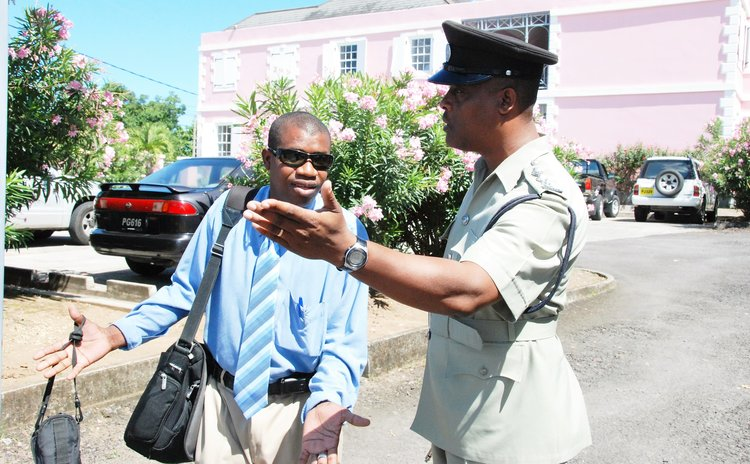 Jno Baptiste, left, is being led out of parliament in 2008