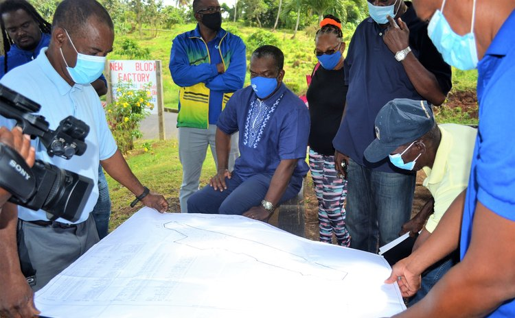 Officials of UWP examine a map of the Wesley area
