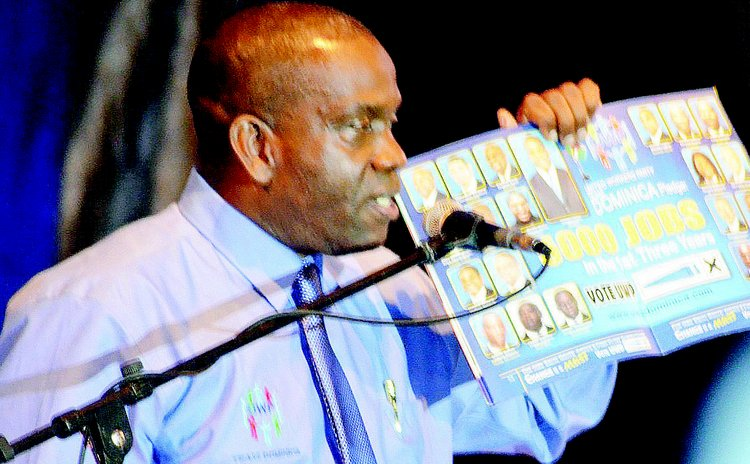 UWP leader Lennox Linton shows inside of manifesto at UWP rally