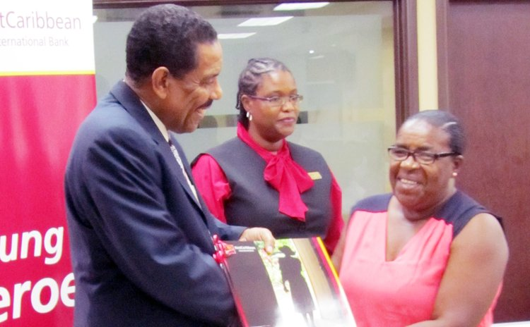 Unsung Herro receives coffee-table book from President Savarin