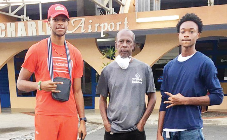 Washway Douglas (Centre) with Jacob Barry and Jarquan Hamilto of the OO Washers Programme