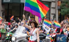 A parader waves a rainbow flag during the annual LGBT Pride Parade in New York, June 28, 2015 (Xinhua/Li Muzi)