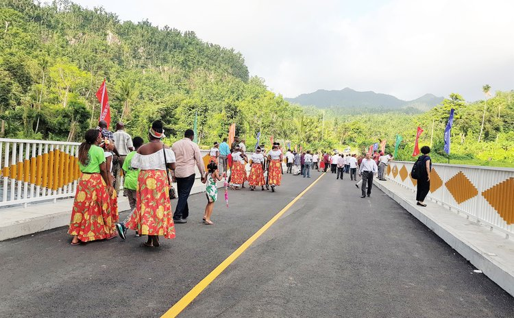 People attending opening ceremony walk on the new York Valley Bridge